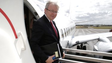Zipping around: Kevin Rudd steps off his jet for another day of campaigning in Brisbane on Monday.