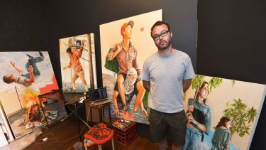 Artist Fintan Magee with some of his work from his Water World exhibition which is inspired by the Brisbane floods.