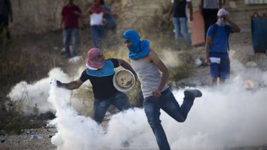 A Palestinian protester throws back a tear gas canister that was fired by Israeli troops during clashes near Ramallah, West Bank, in October. US ambassador Daniel Shapiro has criticised  Palestinians attacks on Israelis.