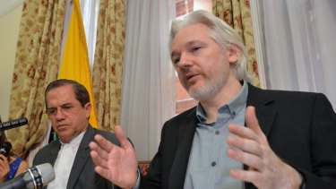 Not much happening: Julian Assange (right) and Ecuadorian Foreign Minister Ricardo Patino address media on Monday at the Ecuadorian embassy.
