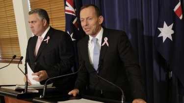 Tony Abbott and Joe Hockey respond to the Mid-Year Economic and Fiscal Outlook at Parliament House in Canberra.