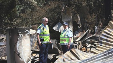 Chief Commissioner Christine Nixon (left) tours Kinglake after the devastating fires with Inspector Ross Smith.