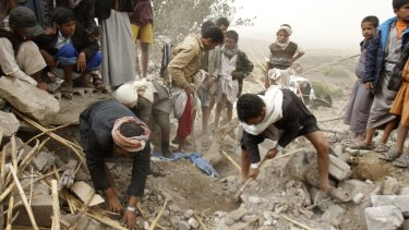 Yemenis search for survivors in the rubble of houses destroyed by Saudi-led air strikes in a village near Sanaa on Saturday.
