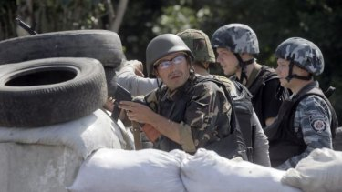 Ukrainian soldiers take a position during a battle with pro-Russian separatist fighters at Slovyansk.