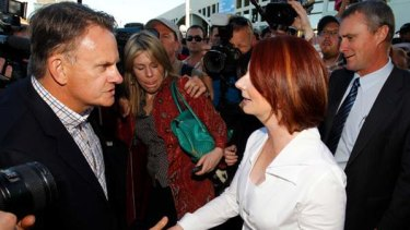 Mark Latham confronts Julia Gillard in Brisbane on Saturday.