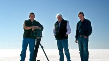 ABC cameraman John Bean, ABC helicopter pilot Gary Ticehurst, and ABC journalist Paul Lockyer stand on the salt pans at Lake Eyre in South Australia in June 2010.
