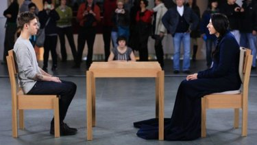Awkward: Marina Abramovic, right, and a visitor to the Museum of Modern art perform <i>The Artist is Present</i> in 2010 in New York.