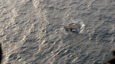 A Japanese home is seen adrift in the Pacific Ocean after the quake and tsunami struck.