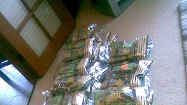 Some of the cash police say they seized during today's  raids.