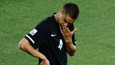 Dejected ... New Zealand defender Winston Reid looks on after the final whistle blew.