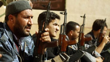 Rebel fighters train in the town of Kabaw, about 230 kilometres southwest of Tripoli.