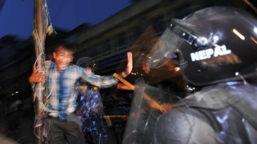 Riot police clash with protesters who fear a federal system.