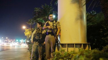 Police officers at the scene of a suspected shooting in Las Vegas.
