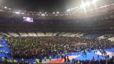 Many fans remained inside the ground and were allowed onto the pitch.
