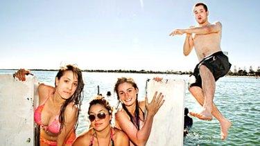 James Bedurke, Emma Patane, Dina Wardell and Mary Tseros take a dip to cool off in the 37-degree heat at Altona Beach on January 13.