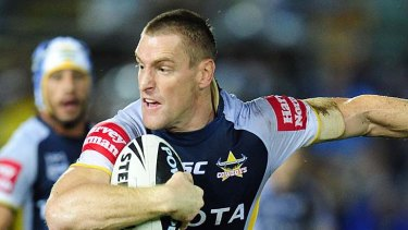Brent Tate of the Cowboys is tackled by Matthew Keating of the Eels.