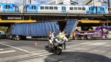 The truck stuck under the rail bridge at Finders Street.