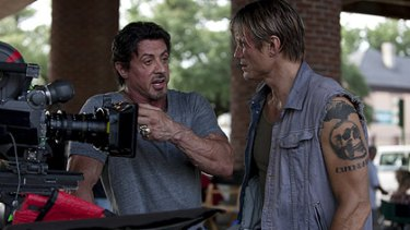 Dolph Lundgren chats to Sylvester Stallone on the set of The Expendables.