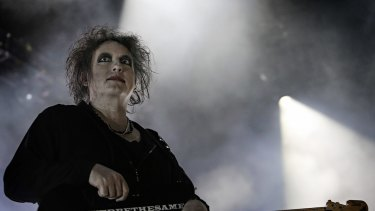 Robert Smith's distinctive ghostly white face, red lips and shock of wild black hair was as quintessentially the Cure as any fan could hope to see.