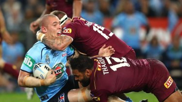 SYDNEY, AUSTRALIA - JUNE 01:  David Klemmer of the Blues is tackled during game one of the State Of Origin series between the New South Wales Blues and the Queensland Maroons at ANZ Stadium on June 1, 2016 in Sydney, Australia.  (Photo by Cameron Spencer/Getty Images)