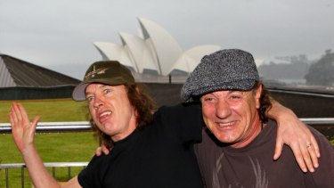 Angus Young on tour with Brian Johnson and AC/DC in happier times.