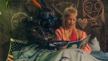 A tender moment amid the madness: Yolandi Visser of Die Antwoord with Chappie.