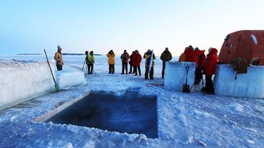 Expeditioners admire a hole they dug in readiness for their 2011 midwinter swim.