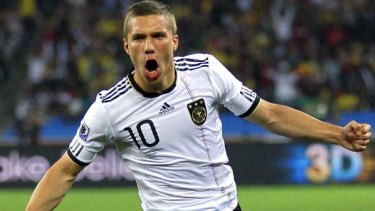 Early blow ... Lukas Podolski celebrates scoring Germany's opening goal after only nine minutes.
