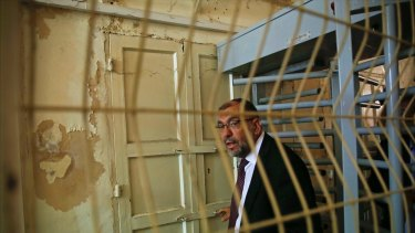 The Mayor of Hebron, Tayseer Abu Sneineh, passes through an Israeli checkpoint to visit an Israeli-controlled part of the West Bank city of Hebron.