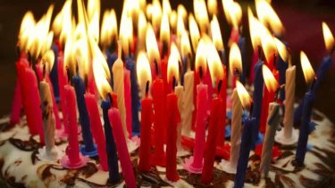 How many candles does it take to declare middle age has struck?