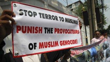 Myanmar Rohingya Muslim protesters rally in front of the Myanmar Embassy in Bangkok, Thailand demanding protection for Rohingya Muslims living in Myanmar, in April 2013.
