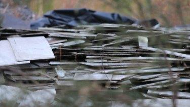 Health danger: Asbestos sheeting at an illegal dump site.