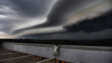 Cleopatra Moir watches a shelf cloud move into Sydney from Terrey Hills.