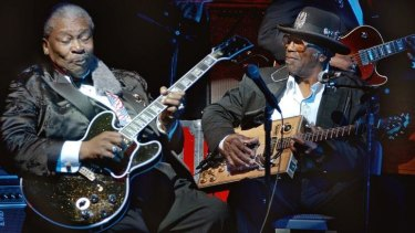 Blues legend BB King, left, performs with Bo Diddley at the second anniversary celebration of BB King's Blues Club and Grill in New York's Times Square in 2002.