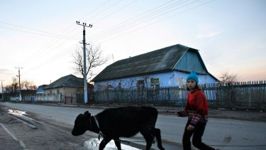 Remote: A young girl walks along a main road in the village of Cosnitsa, Moldova. Transnistria is in a quandary: while it calls itself a country, no one else does.