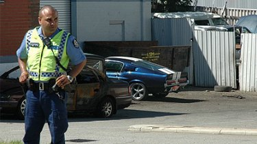 Police seized the blue and white vintage Ford Mustang at a Bayswater salvage yard yesterday.