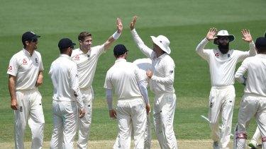 England bowler Chris Woakes dismisses Cricket Australia XI batsman Ryan Gibson.