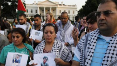 Silent candlelit vigil: The American-Arab Anti-Discrimination Committee and other activists in front of the White House on Wednesday.