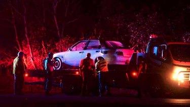 Evidence: police take a car off Ash Island.