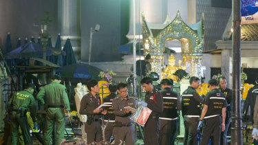 Police investigate the scene at the Erawan Shrine after an explosion in Bangkok, Thailand, on August 17.
