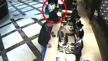 Mahmoud al-Mabhouh (circled) arrives at his hotel in Dubai.
