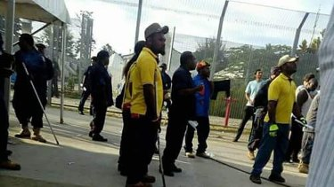 Supplied image of Papua New Guinean police officers entering the Manus Island immigration detention centre on Thursday.