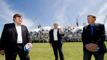 Melbourne Rebels president Gary Gray, CEO Brian Waldron and owner Harold Mitchell outside Melbourne's new rectangular stadium in March.