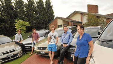 Michael, Shane, John and their parents, Mark and Lynette Rowe, have five cars because of poor public transport services.