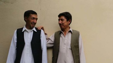 Easing the tension ... Mohammad Akbar Sohrabi, right, shares a tender moment with his cousin, Abdul Rahman Sohrabi,  in Kabul.
