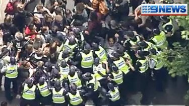 Student protesters clash with police.