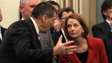 Done deal ... Julia Gillard and former Victorian premier Jeff Kennett in Tasmania yesterday.
