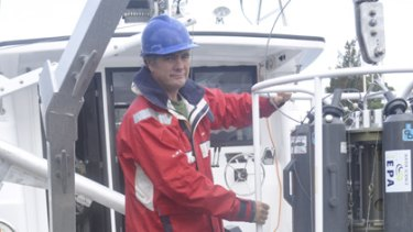 Marine scientist Dr Peter Davies use an oceanographic water sampler in their habitat mapping program.