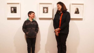 Artist's model... Jesse Hood with his grandmother Cherry Hood and his portrait.