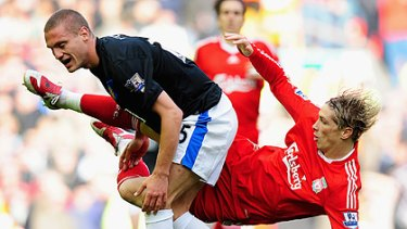 Danger man ... Nemanja Vidic  tangles with Fernando Torres of Liverpool last year.